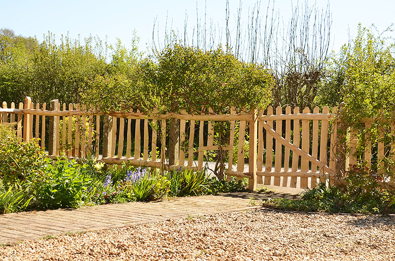 Cleft Chestnut picket fencing re-using existing concrete posts and new sawn oak posts