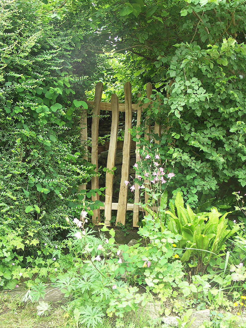 Short section of picket fence used to close off redundant opening